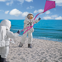 small_astronauts_flying_a_kite_-_aug_2006.jpg